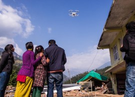 Villagers in Sindhupalchok witness a drone for the first time. Photo: Hannan Lewsley